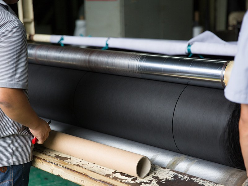Slitting nonwoven rolls into customized sizes